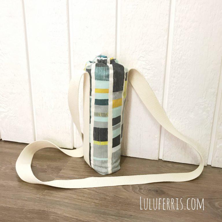 Bolsa térmica para bebidas tipo bandolera con cierre ajustable